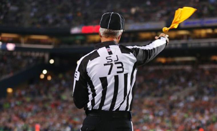 empire-sports-NFL-referee-throwing-flag-no-touch-quarterback-qb.jpg